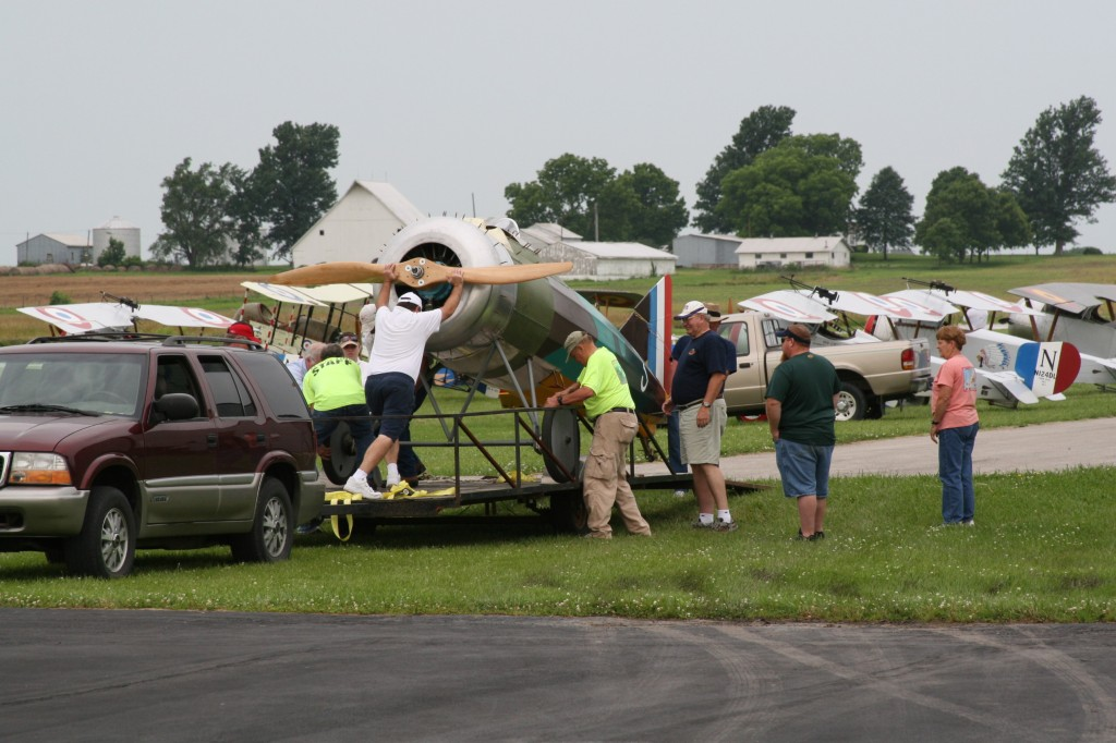 All hands were on deck to remove the Morane from the trailer and roll it to the flight line.