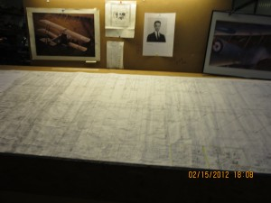 A wide angle shot of the plans on the aviation career school table