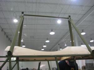 Cabane struts fitted to cockpit decking in hangar at aviation career school